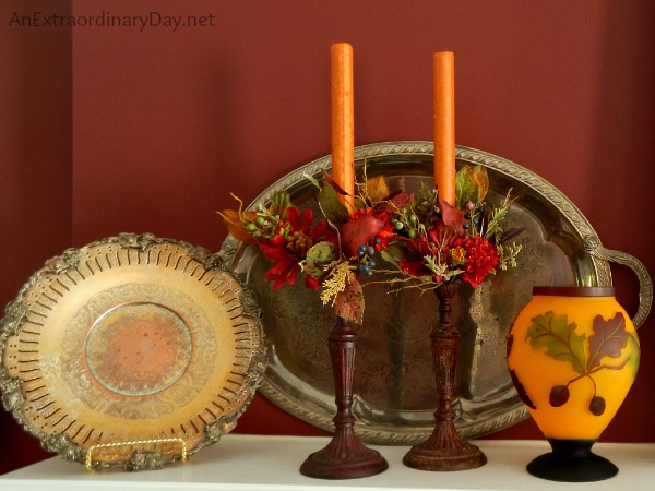 A pretty mantel vignette and tips for dressing a living room for fall.
