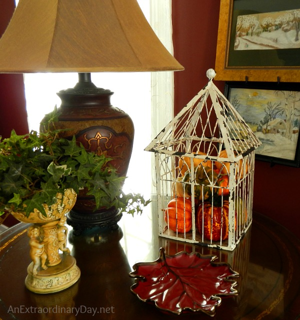 A decorated side table and tips for dressing a living room for fall.