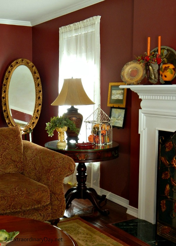 Tips for dressing a living room for fall and a lovely styled end table vignette.