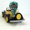 An old roadster bringing home the tree for the Christmas trees on cars blog hop.  AnExtraordinaryDay.net
