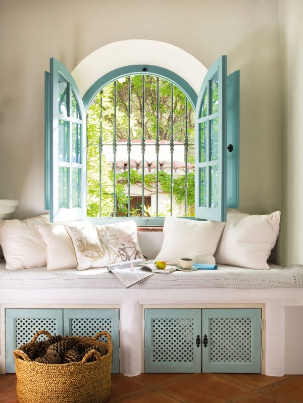Stunning window over a built-in seat in lovely aqua accent colors and the answer to... Why does my favorite color stress me out?