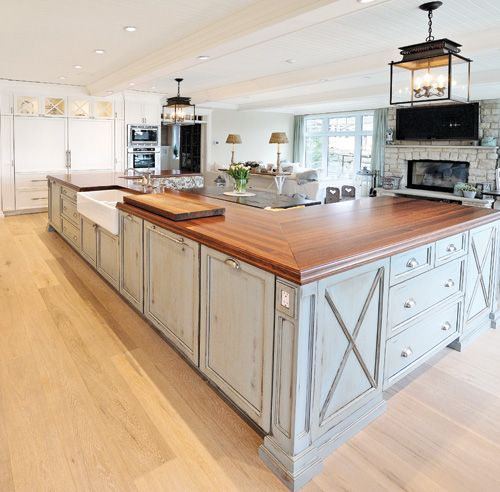 Cape Cod Styled Kitchen with a Built In Seating Island