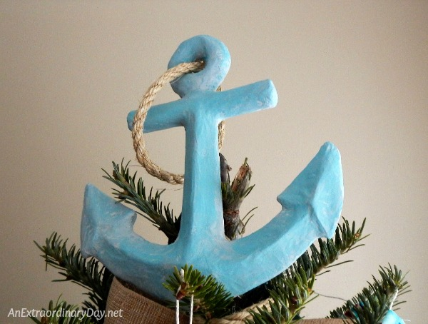 Unique Ways to Decorate a Nautical Christmas Tree - 1 way is to add an anchor for our tree topper
