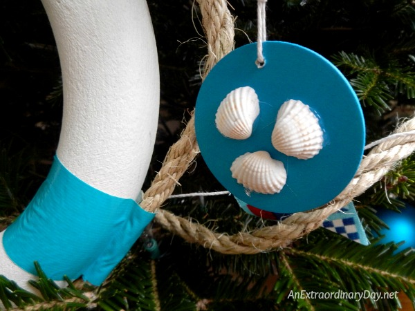 One of Several Unique Ways to Decorate a Nautical Christmas Tree is to use Simple Wood Cutouts and Seashells