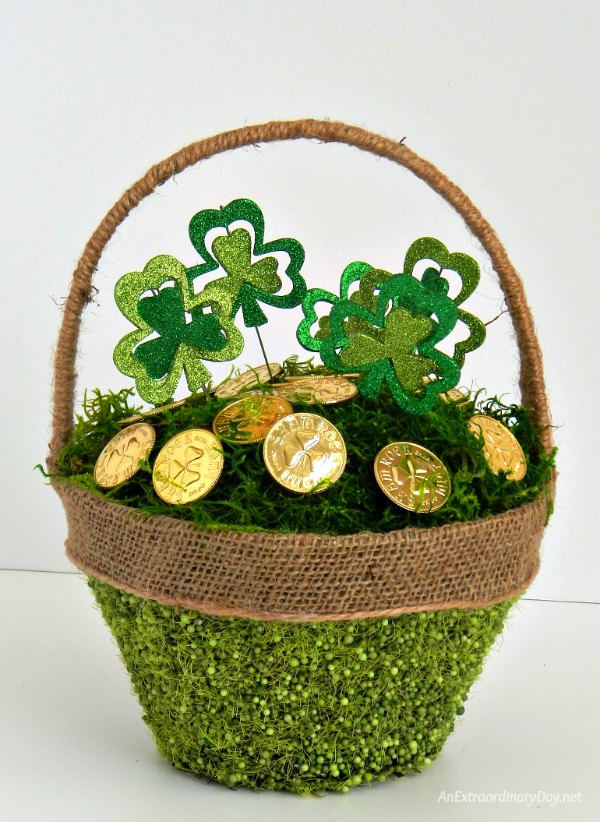 Don't get pinched! Dress your house for the holiday with this Easy to Make St. Patrick's Day Basket filled with Moss, Shamrock Picks, and Gold Coins. It's super easy and low cost, too. Plus... this basket will turn into a lovely Easter Basket very soon. Pin now to remember for later.