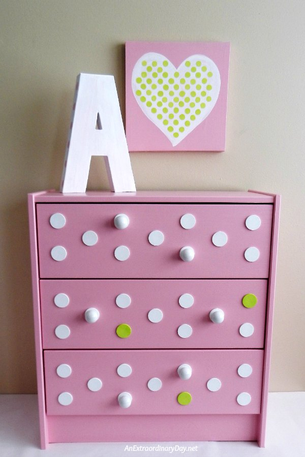Sweet IKEA Rast Hack ~ Pretty in Pink for Baby Girl :: I answered the IKEA Rast Hack Challenge by Hickory Hardware with my pretty in pink polka-dotted dresser for baby girl. Don't miss the tutorial (and mishap) for creating a perfect polka-dot pattern. Be sure to stop by the Hickory Hardware Facebook page - March 9-31, 2016 to vote for your favorite makeover. Nine bloggers are participating in the challenge.