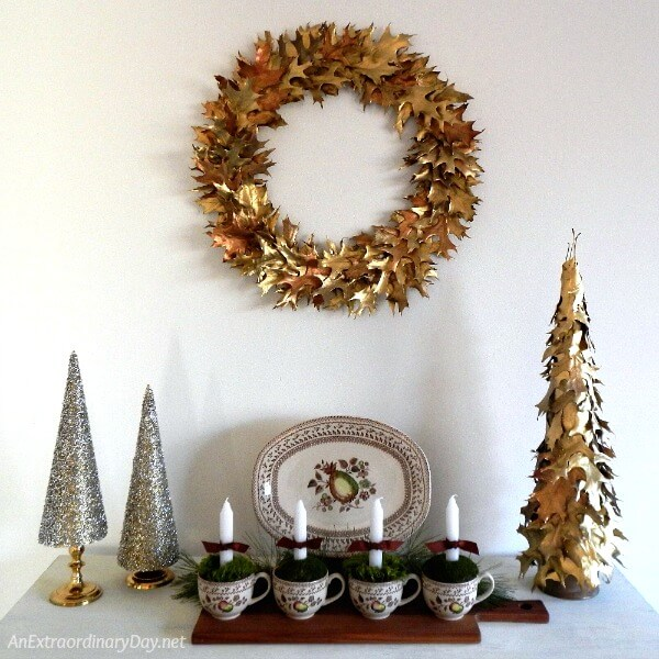 Dress up your home with a classy Christmas wreath made from natural oak leaves and gold paint. AnExtraordinaryDay.net