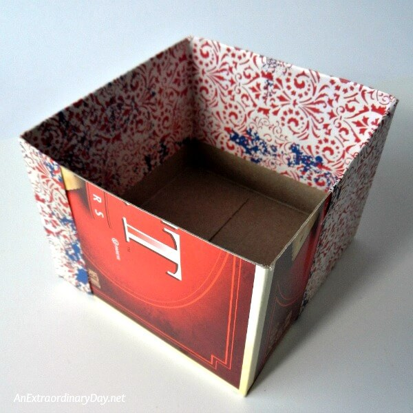 Cut the corners of the paper on the folds to create the flaps for folding over the bottom edge and folding to the inside of the box