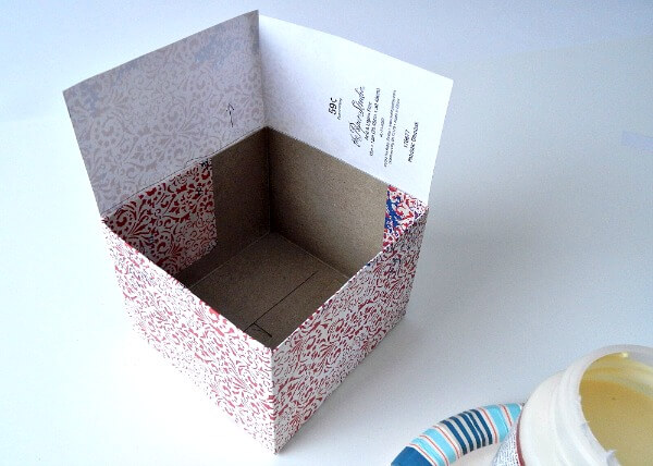 The second sheet of paper will not need to be as long as the first to go around and cover the box.