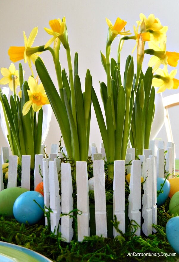 Clothespins become pickets for a fence in this easy and inexpensive Easter Centerpiece