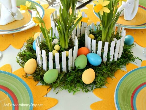 Hand painted plastic eggs now perfectly match the plates on this pretty daffodil inspired Easter tablescape