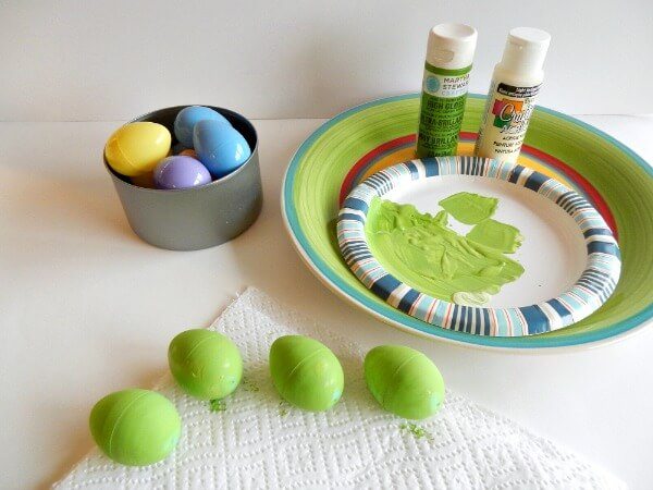 Paint cheap plastic eggs to match dish colors -