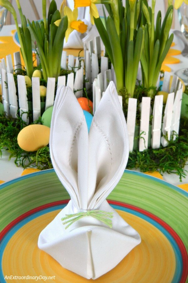 The crowning touch to the Easter table setting is a napkin folded rabbit