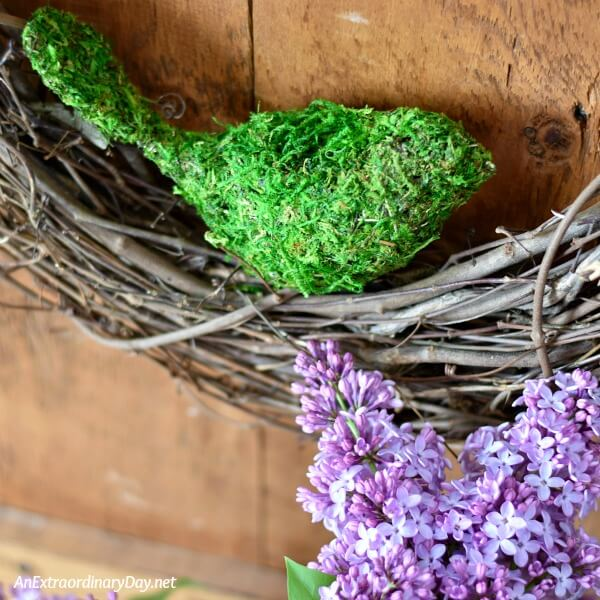 Mossy bird adds to this beautiful lilac vignette