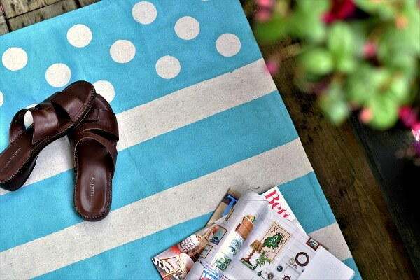 Customize your garden balcony decor with a hand painted floor cloth